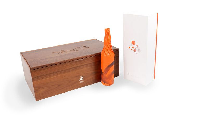 More than a box, Uneka designed a package that takes consumers through the topography of China and the Nine Suns vineyard itself.
